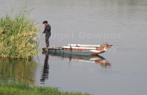 TR-0015 Man in boat on the river Nile