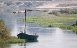 TR-0018 Old sailing boat moored on edge of river Nile