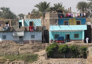 TR-0026 Brightly coloured housing on the Nile bank